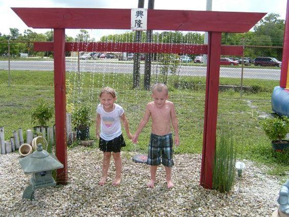 Backyard Getaways Herrin Il :  Gate Rain Curtain A kid friendly water feature by Backyard Getaway