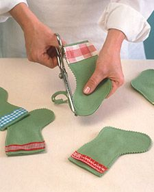 felt mini stockings - they could be used at place settings to hold the silverware or maybe as name tags.: