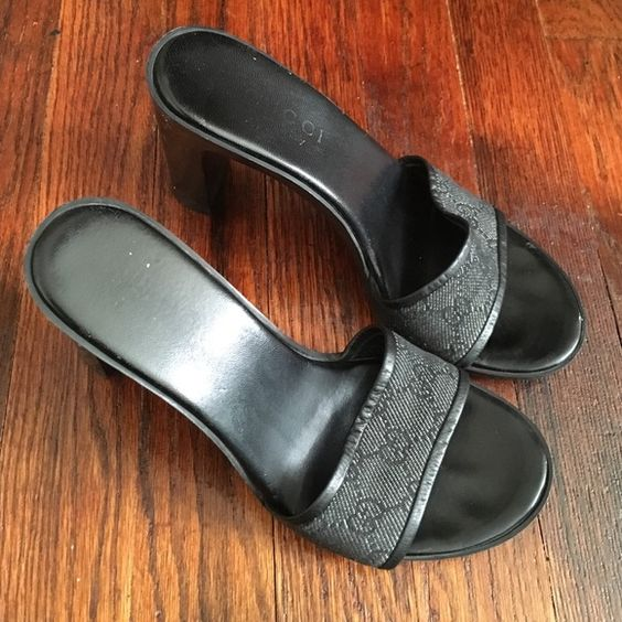 Denim Monogram Slide On Sandals Well worn Gucci slide ons. Dark navy blue. Size 7. Some scuffs, Gucci is faded on insole. Price negotiable. Gucci Shoes Heels