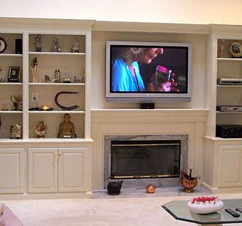 custom made bookcases and fireplace with plasma tv