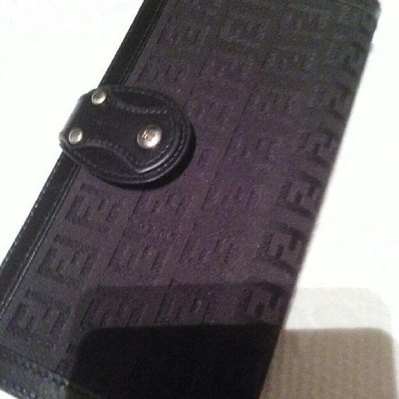 Authentic Fendi wallet Black wallet with  fendi logo n silver hardware slightly ues FENDI Bags Wallets