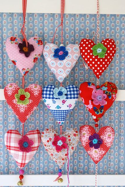 Inspiration - heart ornaments made from pretty fabric scraps, with a felt or crochet flower and a button in the centre - lovely!