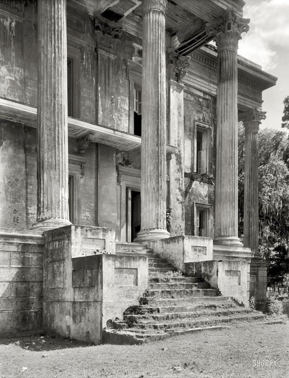 """1938. Iberville Parish, Louisiana. """"Belle Grove. Vicinity of White Castle. Greek Revival mansion of 75 rooms. Ruinous condition. Built 1857 by John Andrews, who sold it to Stone Ware. Occupied by Ware family until circa 1913."""" The decaying portico of what was reputedly the largest plantation home in the South. 8x10 inch safety negative by Frances Benjamin Johnston."""