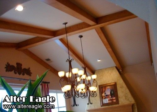 Vaulted ceiling ideas maple beams with corbels on a for Small room vaulted ceiling