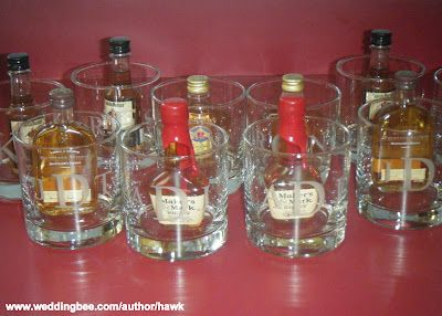 Etched glasses with mini bottles of each groomsman's favorite alcohol. What a sweet idea for the guys (: