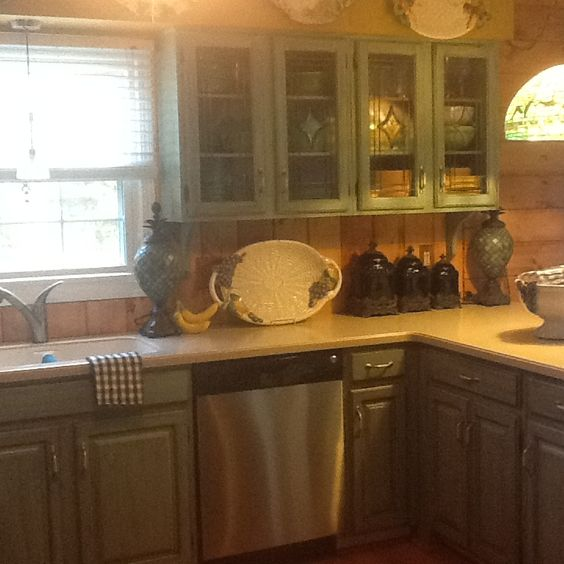 Painted cabinets turquoise with brown glaze Knotty pine walls