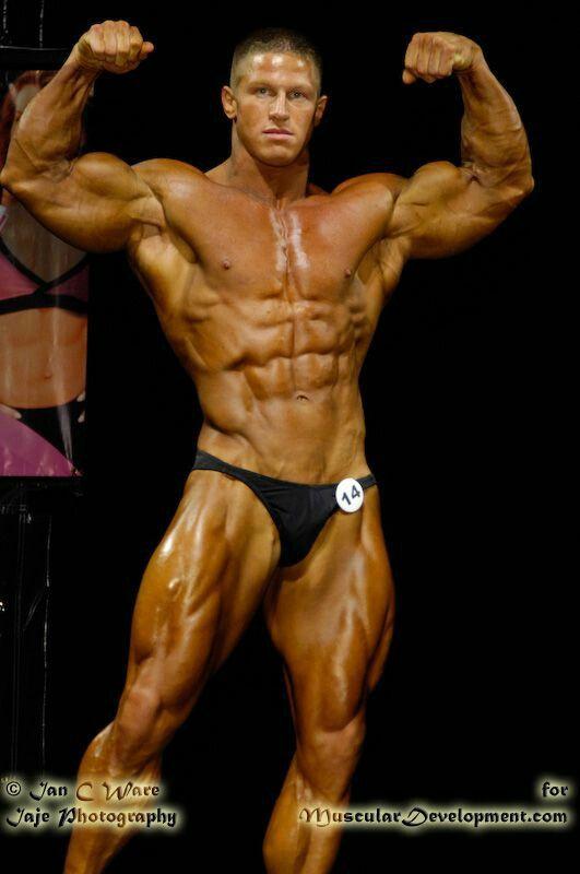 explore stiffness photo body builder pose 001 and more bodybuilding