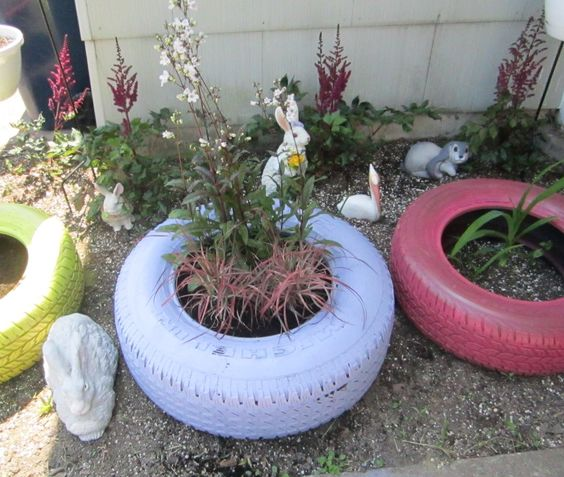 05.13.12 Planted the first tire with Husker Red Penstemon (perennial) and Variegated Purple Fountain Grass ... 2 more tires and 3 hanging baskets to fill ... getting there!