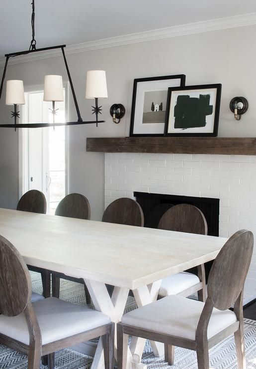 A Etoile Linear Chandelier Hangs Over A Whitewashed Dining Table Surrounded By Gabby Raleigh Side C Transitional Dining Room Dining Table Trestle Dining Tables