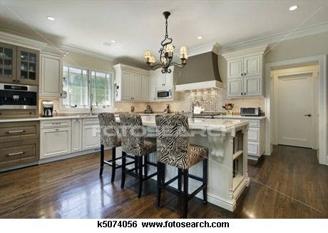 Kitchen with white cabinetry
