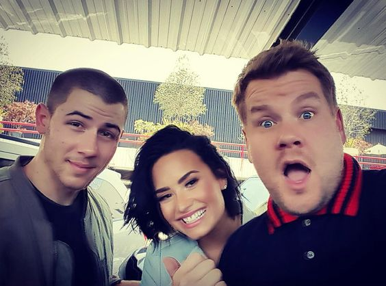 Watch James Corden and Demi Lovato Grill Nick Jonas About Dating Miley Cyrus and Selena Gomez on Carpool Karaoke | E! News