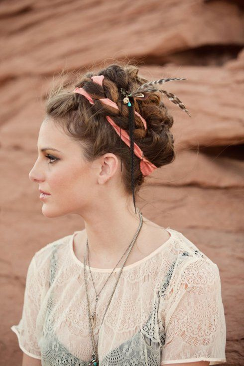Braids with ribbon and feathers.
