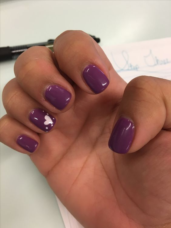 Purple no chip manicure with a small heart design. I had to cut all my nails down due to them breaking after my peach color I had.