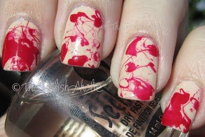 apply a base coat, cover your nail beds with tape, then use a straw to splatter the red.
