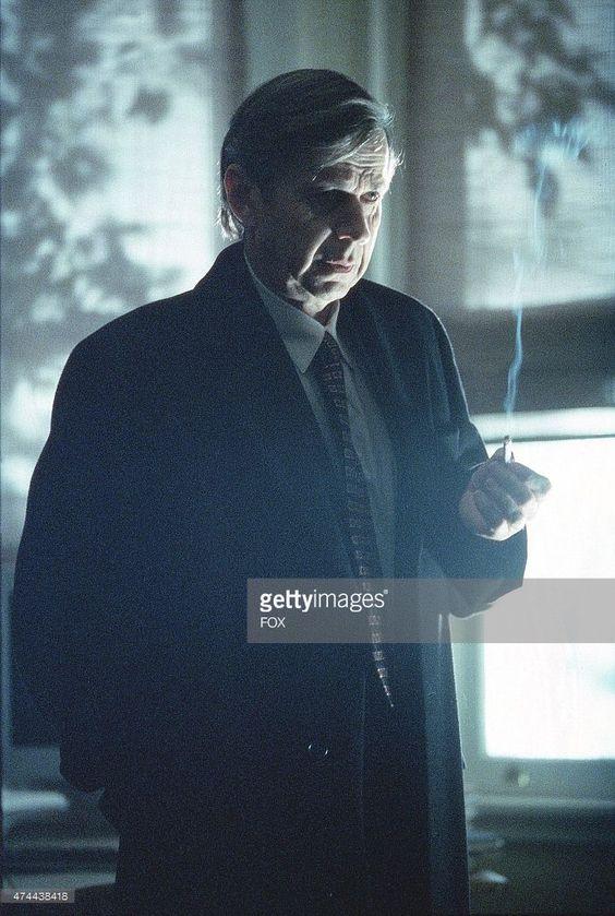 The Cigarette Smoking Man (William B. Davis, pictured) indirectly aides Mulder…