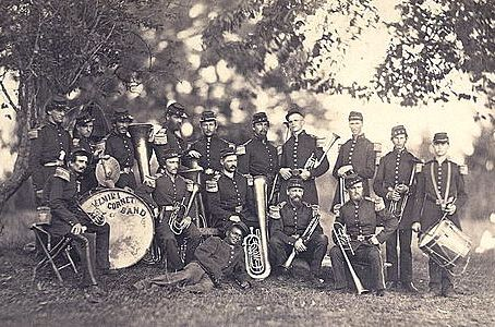 """Civil War Band - """"The two generals had gotten together and agreed upon a truce of sorts, before the battle resumed the next day. The Union band started playing songs, a common occurrence and a pick-me-up for northern soldiers. The Confederates were close enough to hear and would yell across the empty fields. Imagine that: in the cold and damp winter, mostly shoeless Confederates who would yell """"That's a great one,"""" across the field and finally """"Play some of ours!!"""" to remind them of home."""""""