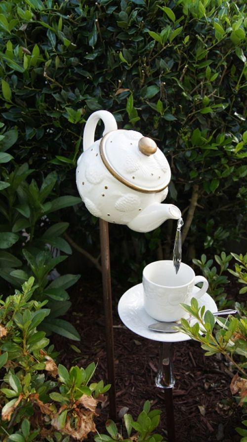 Recycle that Watering Can into Garden Art - The Gardening Cook: