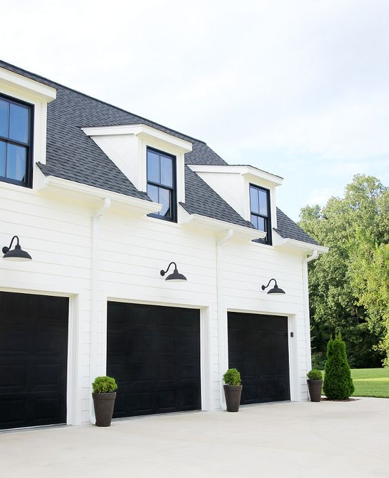 Farmhouse Garage White modern farmhouse with black garage doors The garage doors are standard metal doors, and we used a gel stain by Minwax The color is Antique Black #farmhosuegaragedoor #garagedoor #blackgaragedoor #modernfarmhouse