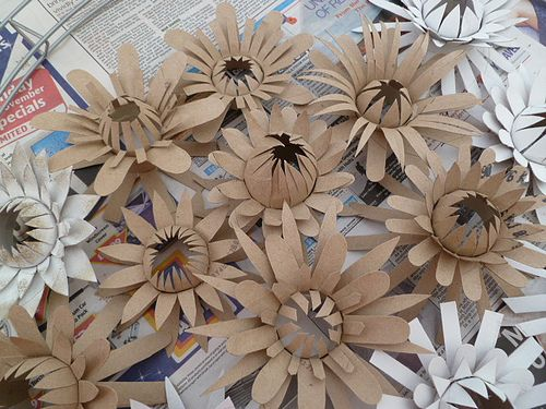 Flowers made with toilet paper rolls this looks like for Crafts made out of paper towel rolls