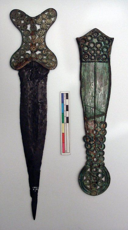 Iron and Copper Alloy Dagger and Sheath Iron Age, Hallstatt D Found Berkshire, England c.600-550 BC Iron dagger with ornate cast copper alloy cross-shaped hilt and matching decorated sheath. The decorative disks presumably held insets, possibly of coral. Blade length: 27.8 cm Source: British Museum