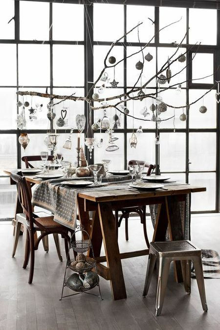 hang a branch over the tables and hang decorations to go with the theme ... butterflies, flowers, snowflakes, ornaments, whatever!