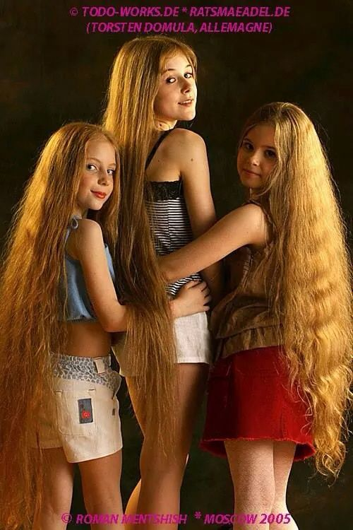 Three beautiful girls with amazing long hair