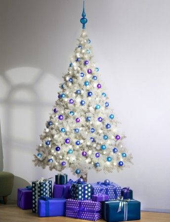 White & Blue & Purple LED lit Christmas tree. Available in 6 ft. or 8 ft. and includes 100 LED lights, plus topper and base decals. Save the paper backing and reuse it next year! From: $135