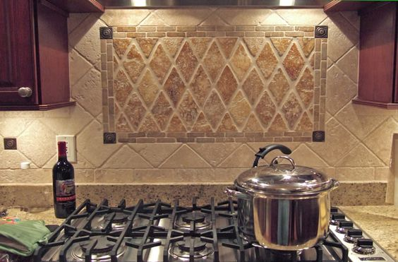 diagonal tile backsplash with harlequin tile inset below range hood