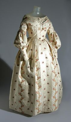 Dress, circa 1837. This dress was made from an earlier English silk dating from about 1772-73 that was probably woven by the English firm Batchelor, Ham and Perigal of Spitalfields, London