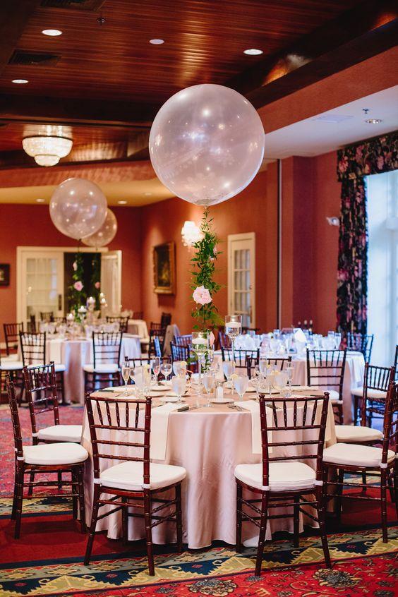 Wedding centerpieces. Balloon centerpieces. Floral garland. Whimsical wedding decor.