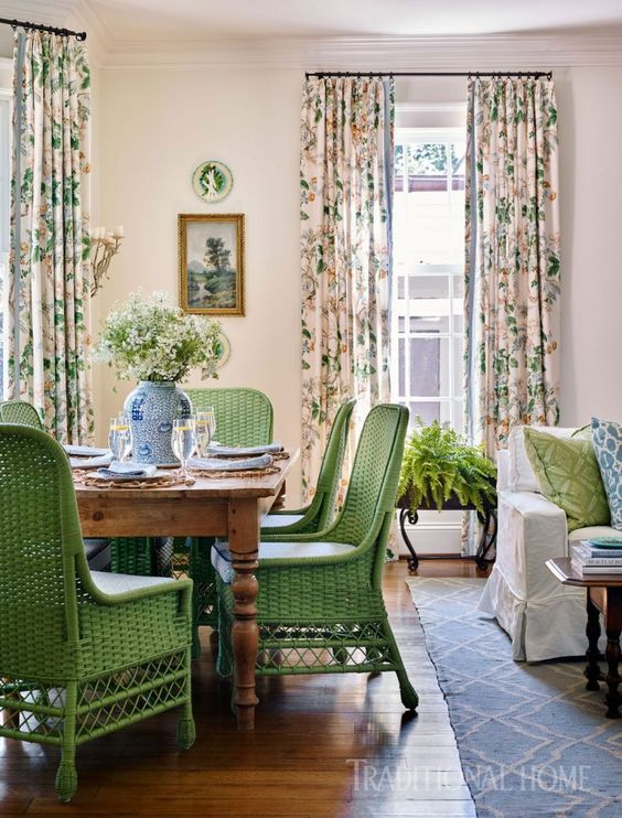 Sarah Bartholomew Traditional Colorful Decor. Vibrant green wicker dining chairs pull up to a pine farm table in a beautiful traditional home.