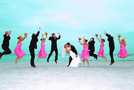 Jump for joy for the bride & groom on the Longboat Key beaches in Sarasota!