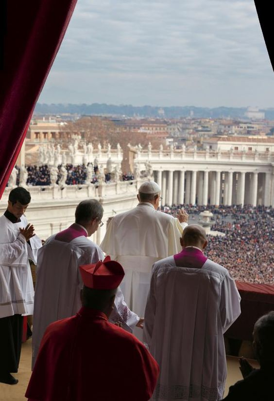 "Standing on a Vatican balcony, Francis addresses the throngs in St. Peter's Square during the traditional papal ""Urbi et Orbi"" address on Christmas Day."