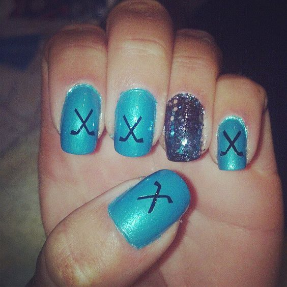 Sharks hockey nails but in Blackhawk colors instead