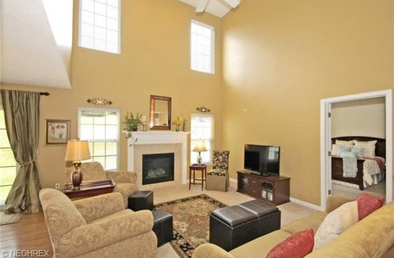 Traditional Living Room with High ceiling stone fireplace Clarke