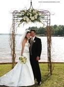 Floral arch for wedding at Ritz Carlton Reynolds Plantation