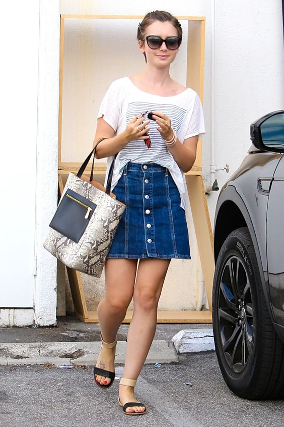 Lily Collins gives the denim skirt trend a try, pairing her Alexa Chung for AG skirt with a slouchy tee and black Yosi Samra Cambelle sandals.   - HarpersBAZAAR.com