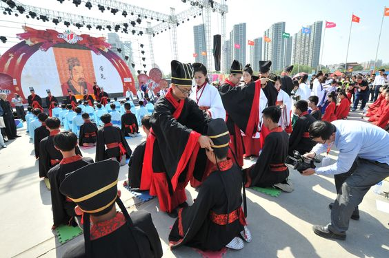 Boys participate in the traditional Chinese coming of age ceremony sponsored by China Yellow River Television. Each boy receives a crown to symbolize become a man. This event was held during the 2nd Shanxi Radio and TV Carnival.