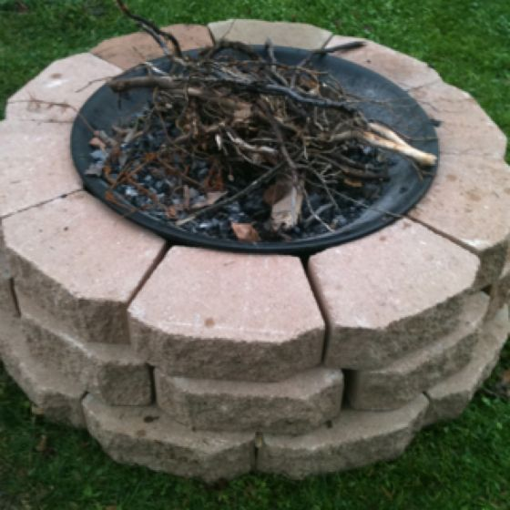 DIY fire pit using landscaping stoned and an old fire pit with the legs taken off!