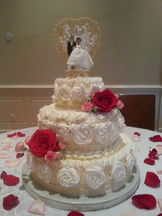 """I made this cake for a very special couple.  The wedding cake topper was from the bride's parent's wedding 38 years ago.  I used Wilton Fondant Ribbon which I coloured with an equal amount of white and gold Pearl Dust.  The ribbon was a great product to work with.  Hint ... the ribbon comes in a roll consisting of 2 - 50"""" pieces.  The ribbon """"stretches"""" as you unroll it so you actually have more to work with."""