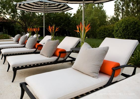 Lounging around in the sun, add some bright colours to cushions to add to the excitement of being outdoors