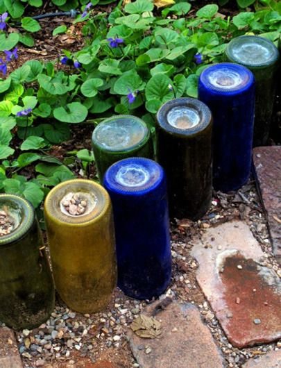 Recycled Wine Bottle Garden Border. Beautiful.   Note to others:  the bulb planter makes the perfect size and depth hole for these.  Note to self:  drink more wine!