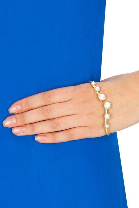 Gold plated pearl palm cuff available only at Pernia's Pop-Up Shop.