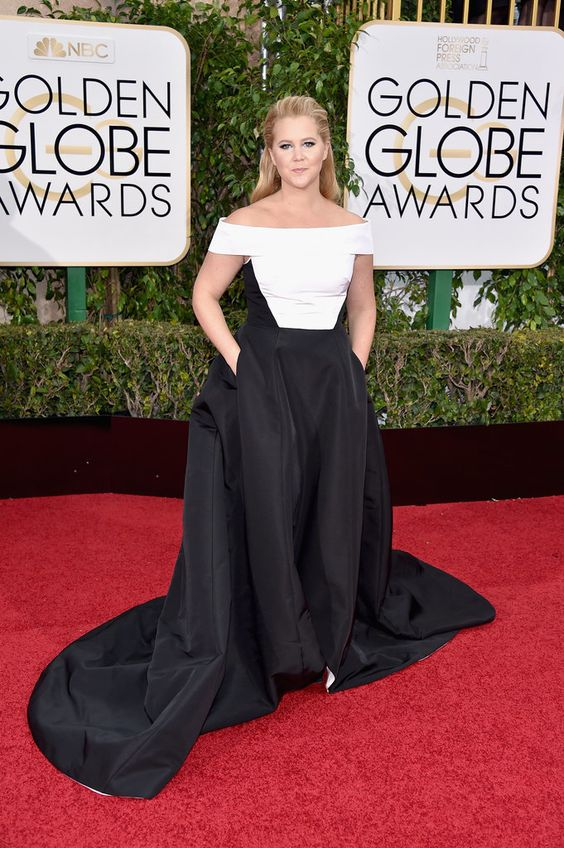 Amy Schumer in a black and white gown.