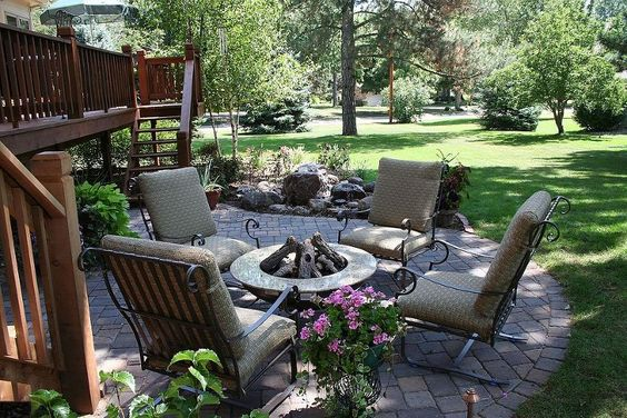 Creating a backyard retreat with a new patio, water feature, and an expanded deck with pergola in Nebraska City, NE