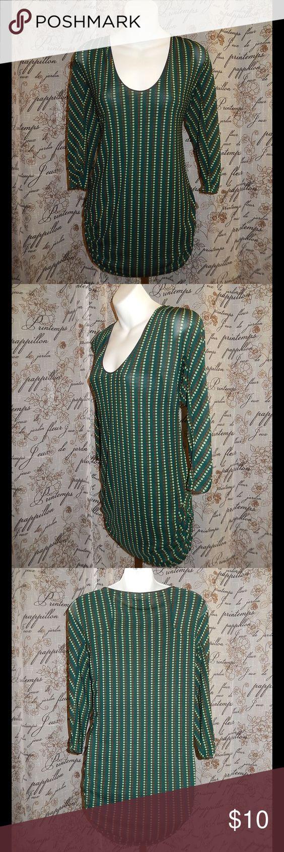 Max Studio Dotted Green Tunic M Max Studio Dotted Green Tunic M MSSP. Shirred sides. 3/4 Sleeves. 95% Nylon, 5% Spandex. Bust 35 1/2. Shoulder to hem 28. Max Studio Tops Tunics