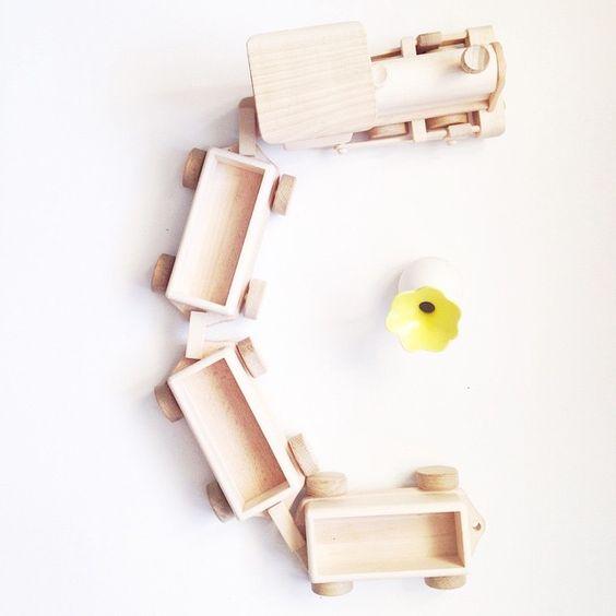 """Grandmother presented Gleb this wooden handmade train from Poland /бабушка привезла Глебу из Польши этот деревянный хендмейд поезд #VSCOcam #vsco…"""