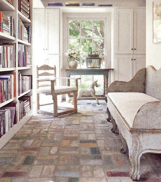 Rustically elegant Swedish antiques and brick floor in a sun room by Jane Moore. Veranda, March 2008.