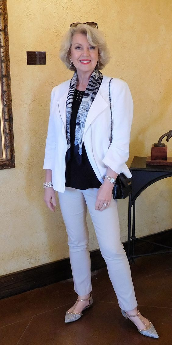 White cord jacket over black tee, pants not so light. Looks as if she's wearing leggings; not with my knobby knees.