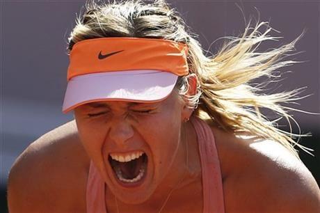 Russia's Maria Sharapova screams after scoring a point during final of the French Open tennis tournament against Romania's Simona Halep at the Roland Garros stadium, in Paris, France, Saturday, June 7, 2014. (AP Photo/Darko Vojinovic) ▼8Jun2014AP|Maria Sharapova looks ahead to Wimbledon http://bigstory.ap.org/article/maria-sharapova-looks-ahead-wimbledon #Maria_Sharapova #French_Open #Internationaux_de_France_de_tennis #Torneo_de_Roland_Garros